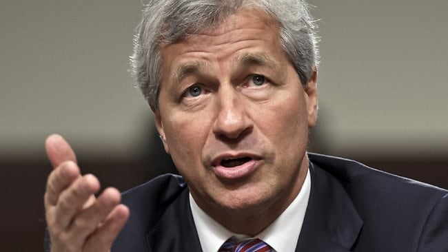 JPMorgan Chase CEO Jamie Dimon testifies before the Senate Banking Committee. His former CFO says Dimon withheld reports on the losses from US regulators.
