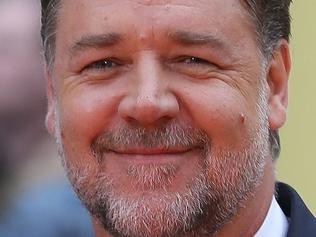 "Australian actor Russell Crowe poses as he arrives to attend the UK premiere of the film ""The Nice Guys"" in Leicester Square in central London on May 19, 2016. / AFP PHOTO / JUSTIN TALLIS"