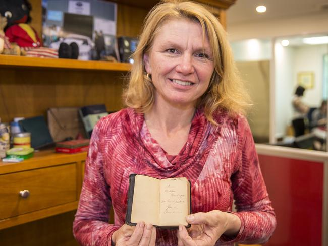 "Sandie holds the tiny bible inscribed with ""From Mother, Nov 11th 1915 On his departure from Australia."" Picture: Richard Tuffin"