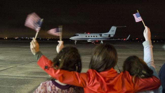 Astronaut Scott Kelly's girlfriend, along with Kelly's daughters Samantha, left and Charlotte, right, welcome Kelly home. Picture: Joel Kowsky/NASA via AP.
