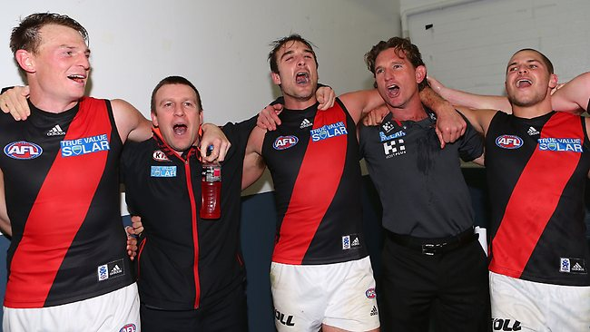 Brendan Goddard, a member of the club's support staff, Jobe Watson, James Hird and David Zaharakis sing the club song after beating the West Coast Eagles at Patersons Stadium. Picture: Getty Images