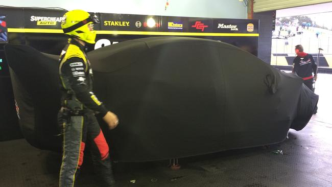 Slade's car, covered up in the garage ahead of Race 27.