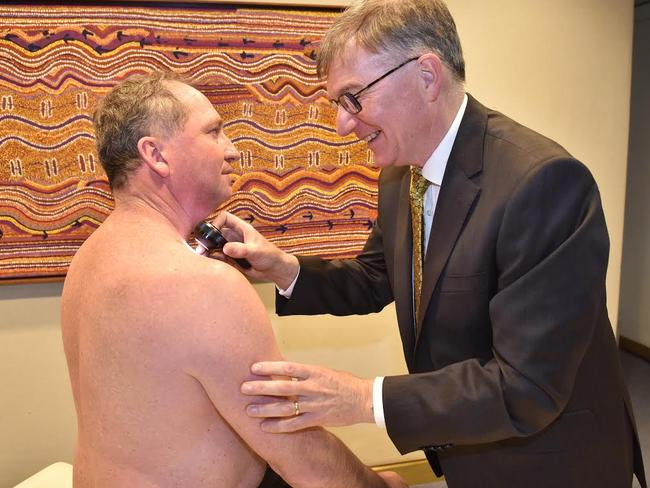 Barnaby Joyce, pictured having a skin check by Professor Andrew Miller, has long been an advocate for sun safety. Photo: Mark Graham