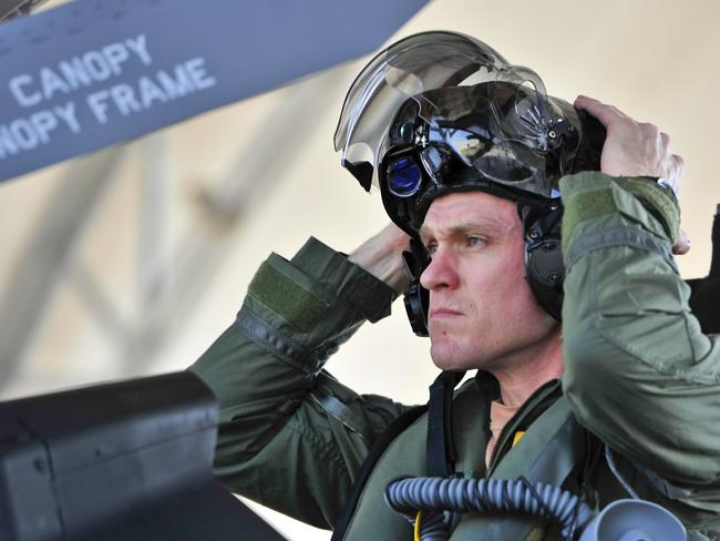 Royal Australian Air Force Squadron Leader Andrew Jackson, F-35 Lightning II student pilot, puts on his 'virtual reality' helmet before his first flight in an F-35A. Picture: US Air Force