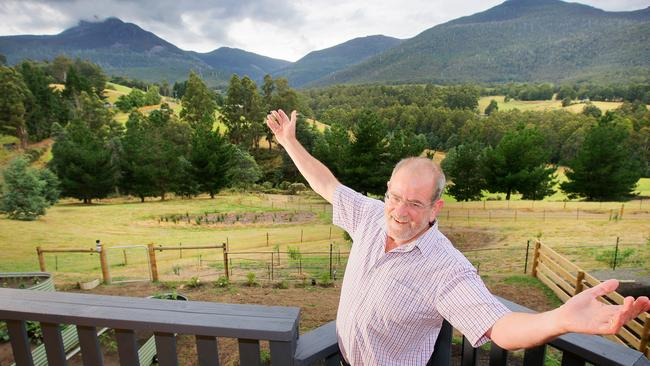 Gavin Mooney pictured in front of his Mountain River home in Tasmania.