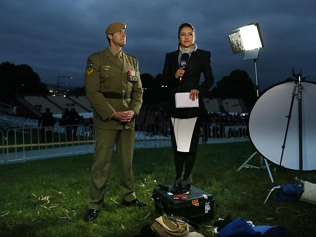 A Channel 10 reporter was forced to stand on a boz when interviewing Corporal Ben Roberts-Smith VC at the Canberra dawn service. Picture: Gary Ramage