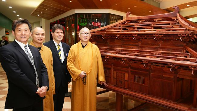 Bruce Zhong, CEO of Australia China Theme Park (far left), Master Yao Ru, Wyong Mayor Doug Eaton, and Master Yao Lai with a model of the proposed Chinese temple destined for the ChappyPie theme park on display at Westfield Tuggerah. Picture: Peter Clark
