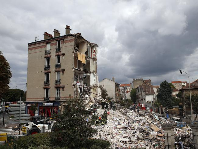 Rubble ... French firemen search in the rubble of the building after an explosion, believed to be caused by a gas leak. Picture: AP