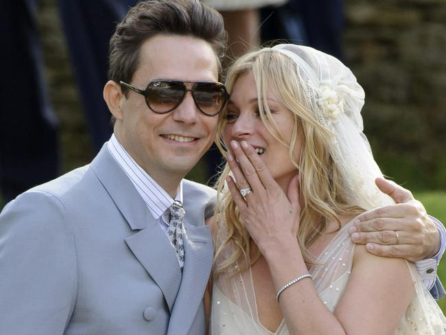 Protective ... British model Kate Moss and British guitarist Jamie Hince after their wedding in 2011.