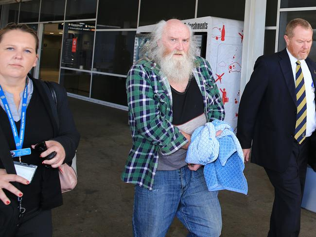 Colin Michael Newey arrives at Sydney Airport this afternoon flanked by NSW cold case detectives. Picture: Mark Evans