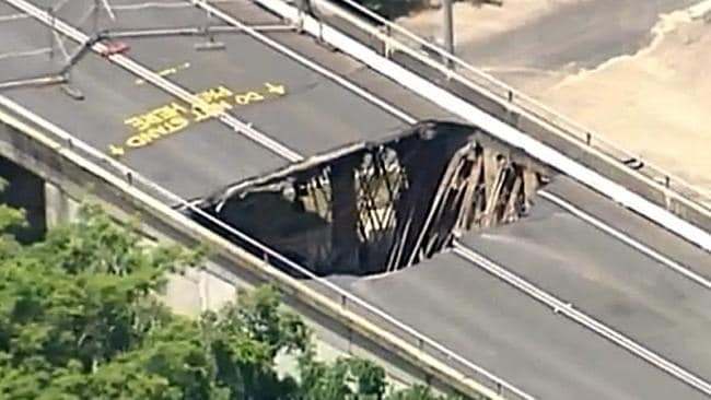 AFTERMATH: A massive hole in a road after flooding at Bundaberg. Picture: Channel 9