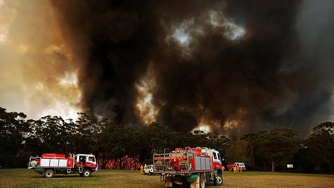Fire threatens St Columba's High School in Springwood on day three of the NSW bushfires.