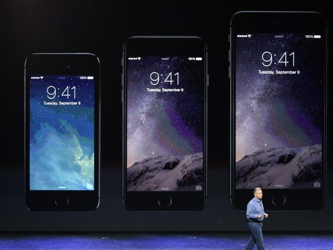 Unveiling ... senior vice president Phil Schiller discusses the new iPhone 6 (centre) and iPhone 6 Plus. Picture: AP