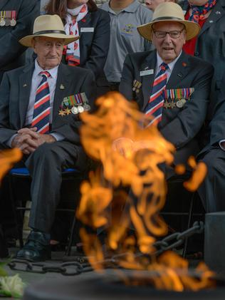 D-day veterans Fred Cecil Riley and Francis (Bill) Owen Evans at the Eternal Flame in Paris. Picture: Alastair Miller