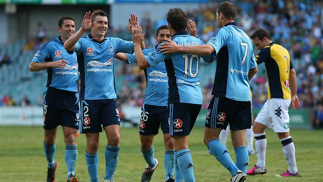 Sebastian Ryall of Sydney FC celebrates scoring a goal with team mate Alessandro Del Pierro during the round 24 A-League match between Sydney FC and the Central Coast Mariners at Allianz Stadium.