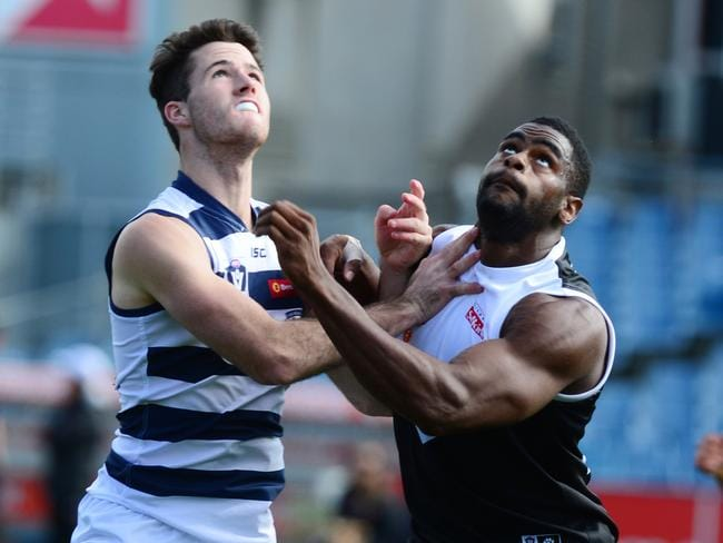 Eric Wallace (right) battles for the ball for North Ballarat.