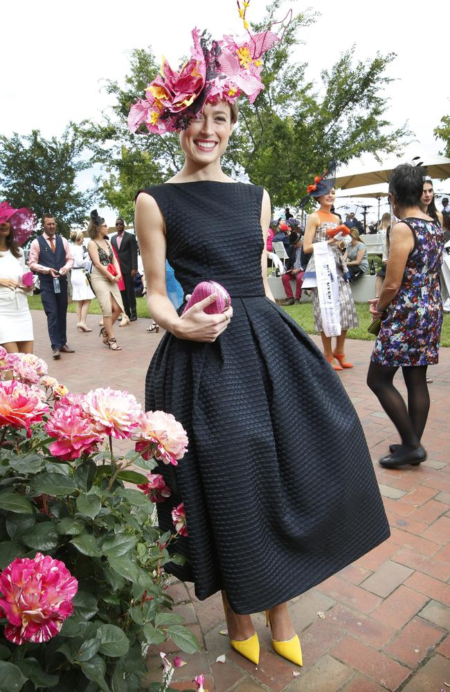 Winner of Melbourne Cup Fashion in the Field Emily Hunter in a dress made by her mother. Picture: David Caird.