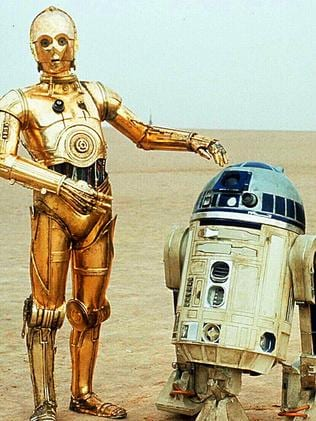 R2D2 and C-3PO ... In a scene from Star Wars.