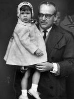 <p>Prince Rainier of Monaco carrying a young Princess Caroline at Cointreau Airport, Geneva. Picture: Supplied</p>