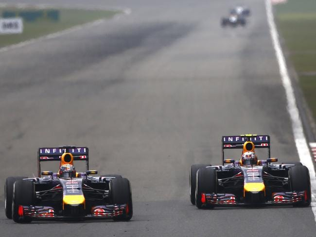 Sebastian Vettel and Daniel Ricciardo battle for position.