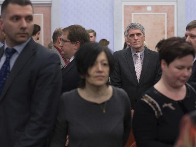 Members of Jehovah's Witnesses react in a courtroom after judge's decision in Moscow, Russia. Picture: AP