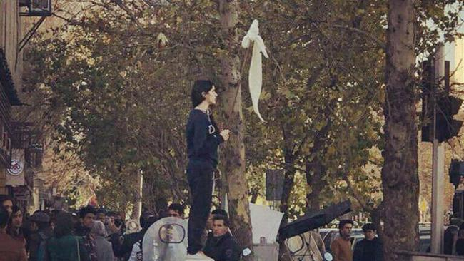 The lone woman has become a symbol of protest in Iran for those fighting against the compulsory hijab.