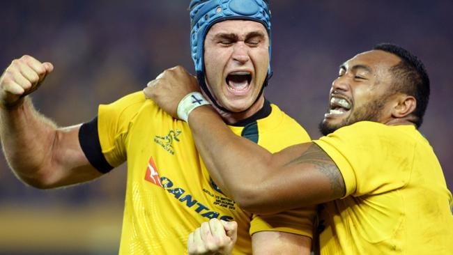 Australian Wallabies captain James Horwill (L) and prop Sekope Kepu (R) celebrate after defeating the British and Irish Lions. Picture: AFP