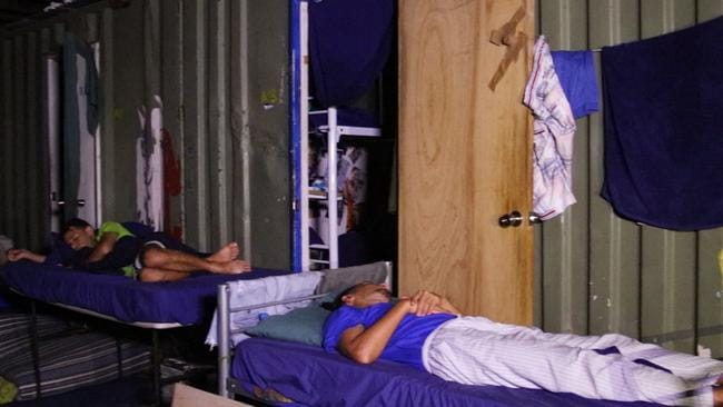 The refugees have started sleeping on tables outside to escape the sweltering conditions inside cramped shipping containers. Picture: GetUp Australia