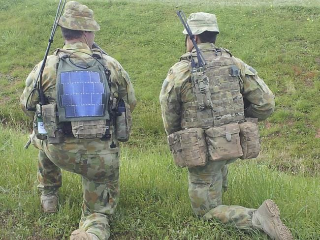 Lighter to carry ... Soldiers have been trialling solar power packs to charge batteries and devices such as laptops. Picture: ADF.