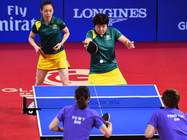 Jian Fang Lay and Miao Miao of Australia compete against Tianwei Feng and Mengyu Yu of Singapore.