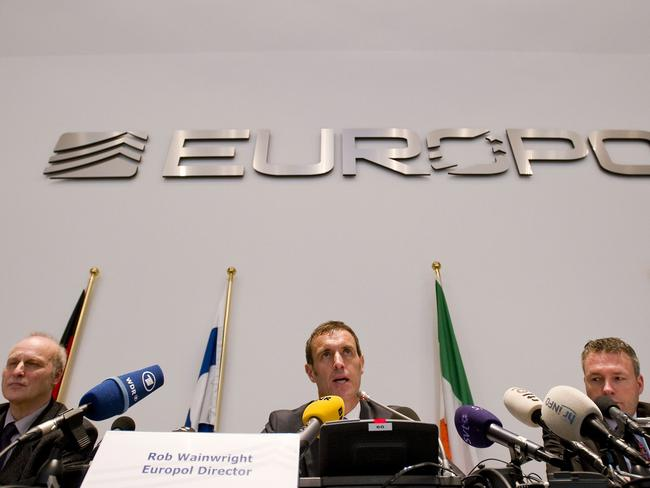 New front ... Europol's chief Rob Wainwright, centre, said the organisation aimed to identify the ringleaders behind online propaganda. Picture: Robin Van Lonkhuijsen/AFP