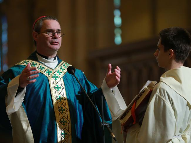Bishop Peter Comensoli leads the Mass. Picture: Toby Zerna