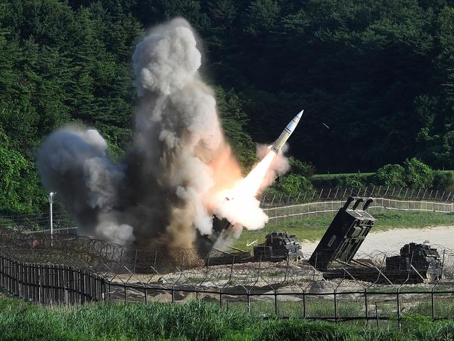 The US M270 Multiple Launch Rocket System fires an MGM-140 Army Tactical Missile during a US and South Korea joint missile drill. Picture: South Korean Defence Ministry via Getty Images