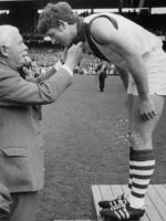 South Melbourne's 1970 Brownlow Medal winner Peter Bedford receives his medal from the governor Sir Rohan Delacombe.