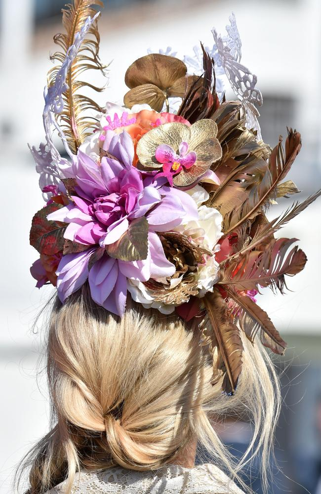 A woman sports a fancy hat at Flemington Racecourse on Melbourne Cup day in Melbourne on November 3, 2015. Picture: AFP PHOTO/Paul CROCK