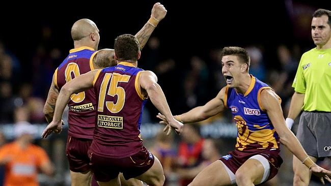 Ash McGrath of the Lions celebrates kicking the winning goal after the siren against Geelong. Picture Darren England.