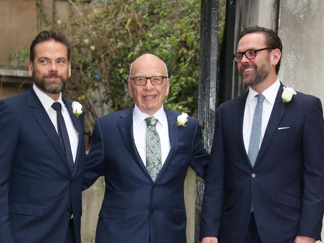 Lachlan Murdoch, Rupert Murdoch and James Murdoch arrive at St Bride's Church. Picture: Joel Ryan/Invision/AP