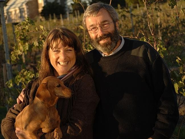 Prue and Stephen Henschke of Henschke winery — with pet dog Cassia in the Hill of Grace vineyard.