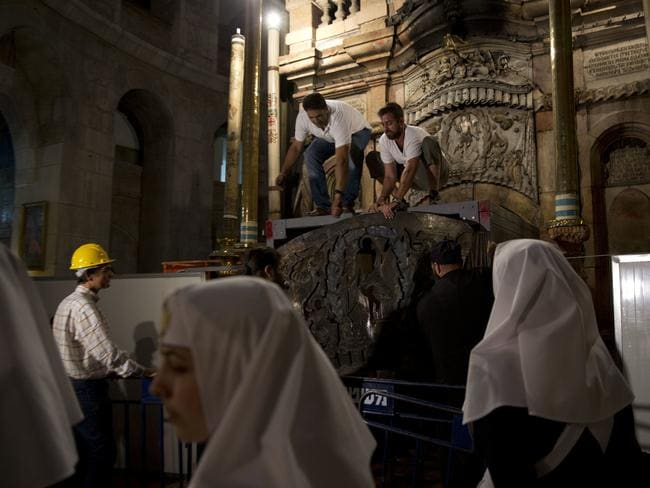 Christian nuns supervise experts renovating Jesus' tomb in the Church of the Holy Sepulchre. Picture: AP