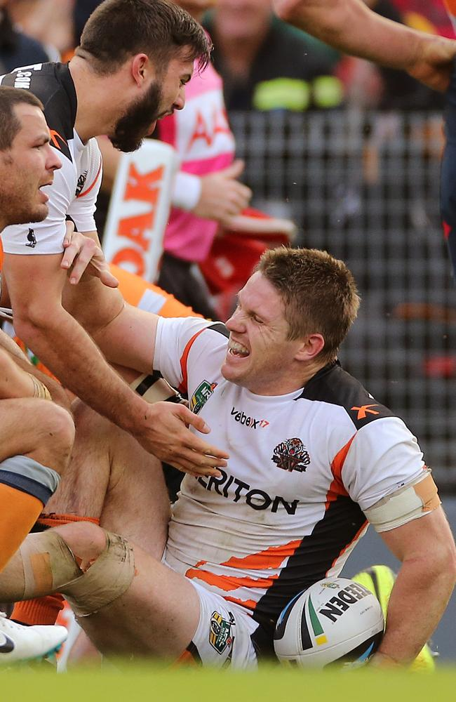 Chris Lawrence celebrates a try.