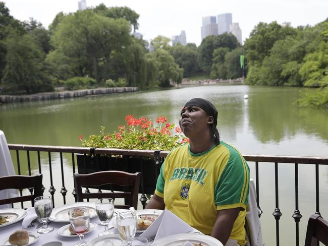 Shatima Davis, an occasional resident of the New York Rescue Mission, enjoys an appetiser at The Loeb Boathouse. Pic: Seth Wenig.