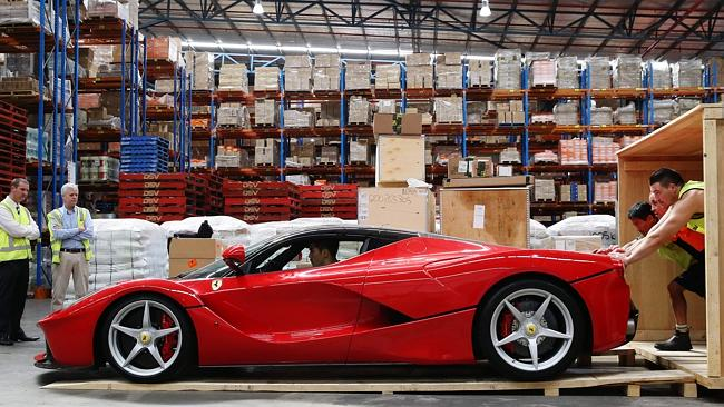 On a roll: The La Ferrari is unshipped from its crate ahead of its appearance at Sydney's Eastern Creek Raceway next weekend. Picture Craig Greenhill
