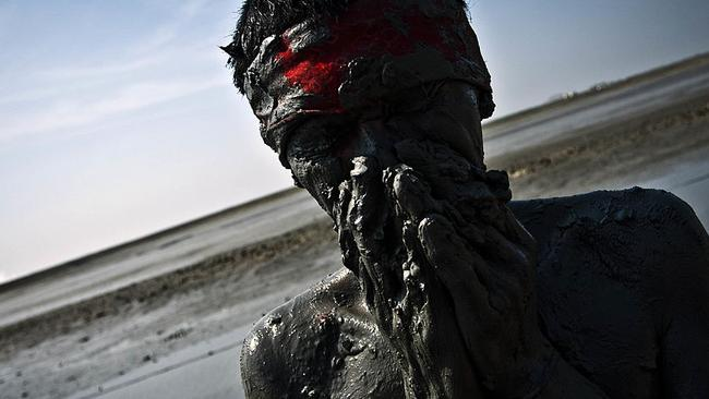 An Indonesian activist smears his body with mud at the five year anniversary of the Sidoarjo mud eruption on May 29, 2011. Picture: Getty.