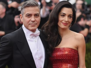 "George Clooney and Amal Clooney attend the ""China: Through The Looking Glass"" Costume Institute Benefit Gala at the Metropolitan Museum of Art on May 4, 2015 in New York City. (Photo by Mike Coppola/Getty Images)"
