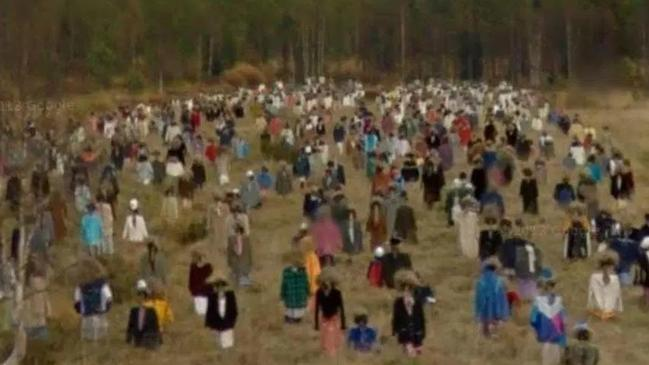 A closer look reveals that the figures are actually scarecrows. Picture: Google Maps