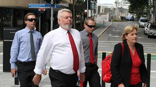 Bruce and Denise Morcombe followed by their sons Dean and Bradley at the Brisbane Supreme Court this week. Most days they wore red - the colour of Daniel's t-shirt when he disappeared, which now signifies the foundation established in his honour.