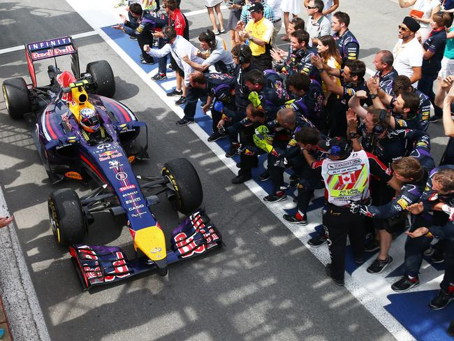 Returning to the pits to the cheers of his Red Bull crew.