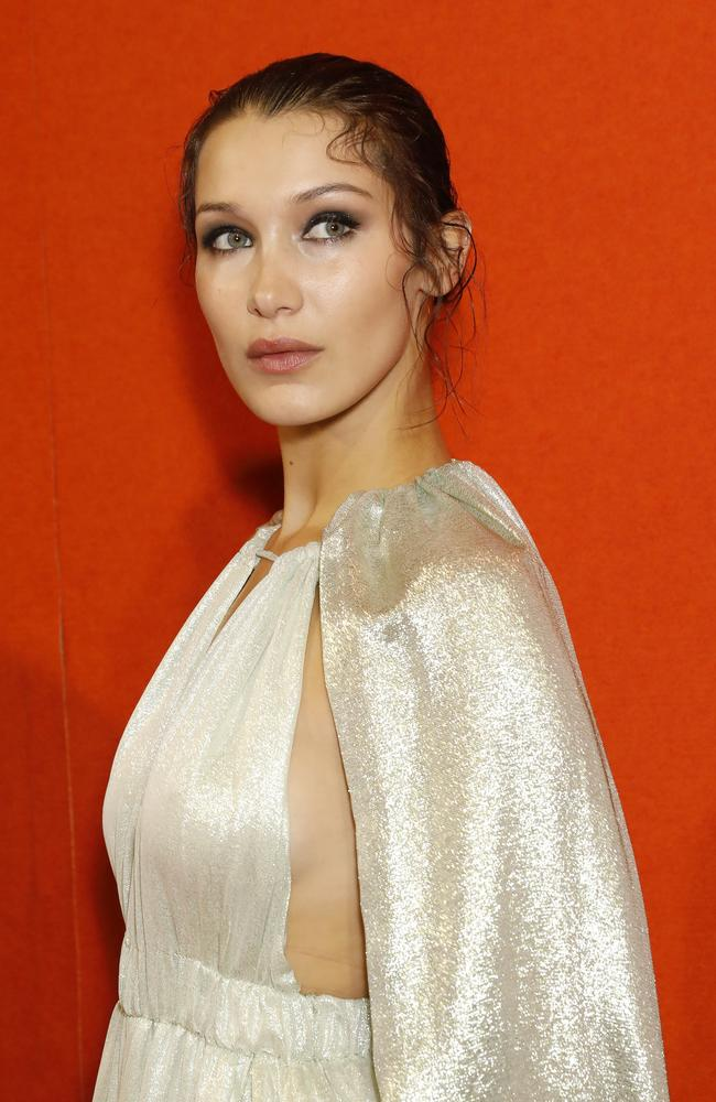 Golden girl Bella Hadid backstage at Alberta Ferretti.