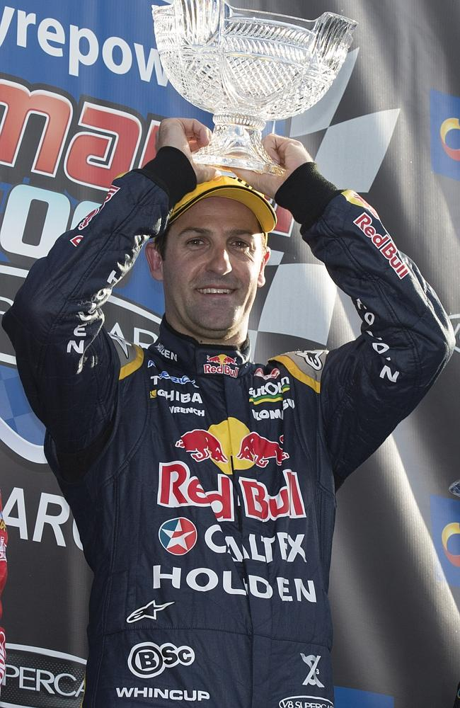 Holden's Jamie Whincup celebrates victory in Tasmania in March.