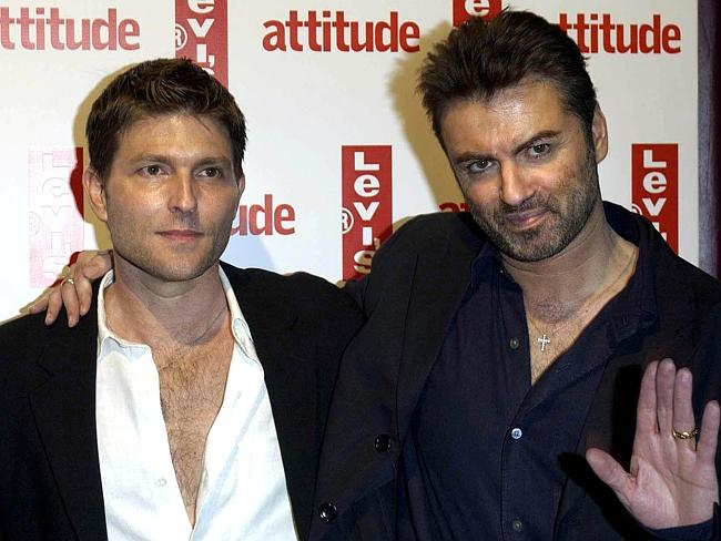 Singer George Michael (R) and his then partner Kenny Goss arrive for Attitude Magazine's